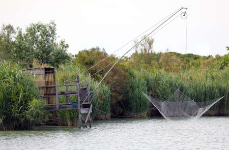 large fishing net without fish on the bank of the great river Banque d'images