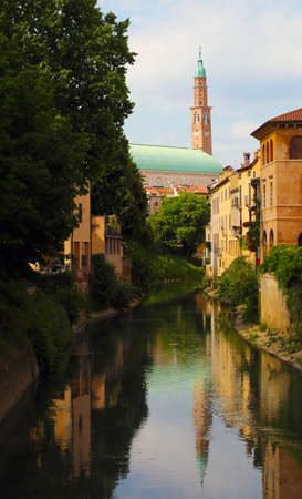 high Tower called Torre Bissara in Vicenza City in Northern Italy and the Retrone River in downtown Stock fotó