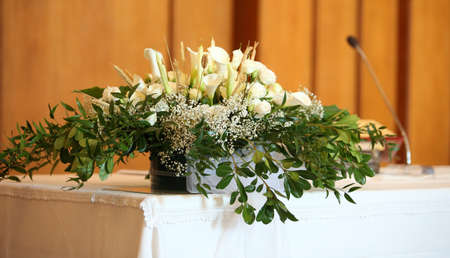 pot of flowers in the altair in the church without people