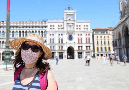 pretty woman with surgical mask in Saint Mark Square in Venice in Northern Italy