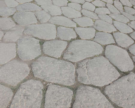 background of old stones of an ancient roman road in Italy Banque d'images