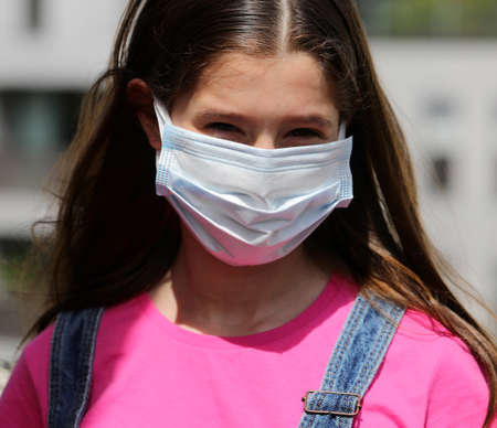 cute girl with long black hair and surgery mask for protection from virus crown