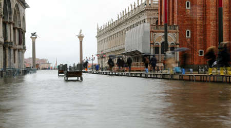 pedestrian walkway in Venice in Italy during flood in winter