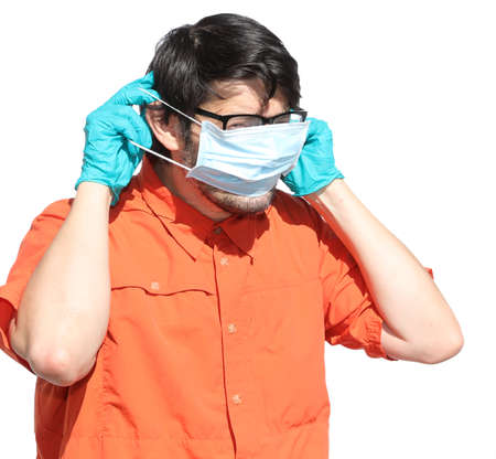 man with glasses shows how to correctly wear the surgical mask to protect himself from the coronavirus Stock Photo
