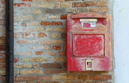 red mailbox for posting letters and postcards