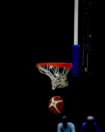 fantastic basket with the basketball ball and the black background of a sports hall