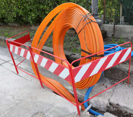 pipe to lay the fiber optic infrastructure in a city road construction site