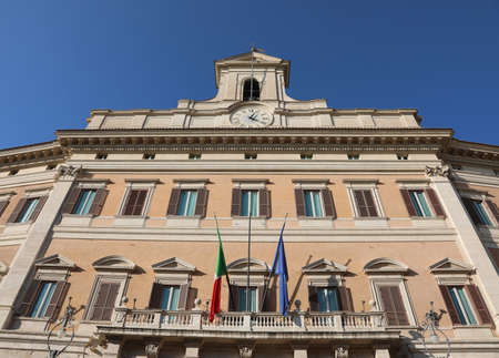 Rome, RM, Italy - March 3, 2019: Italian Parliament called Montecitorio and italian and european flags Editorial