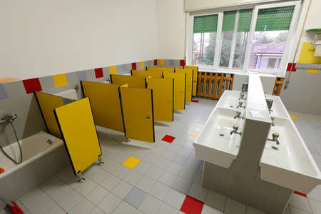Kindergarten bathroom with yellow doors but without the children who stayed home because of the coronavirus epidemic