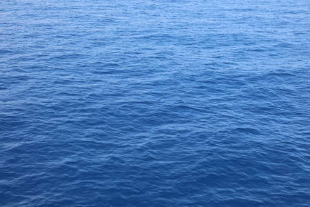 lovely blue uniform sea background with water without people and without boats Foto de archivo