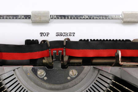 vintage typewriter the text TOP SECRET on the white sheet