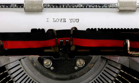 vintage typewriter the text I Love You on the white sheet