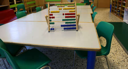 school classroom with wooden abacus above the table to teach children to count