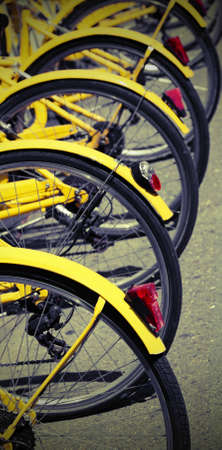 MANY yellow bikes of the sharing bike system with vintage toned effect
