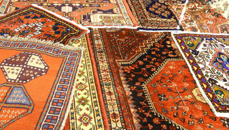 background of many rare carpets for sale in the market Foto de archivo