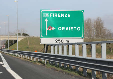big traffic sign to go to Florence City or Orvieto town in the italian Motorway Foto de archivo