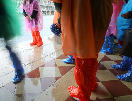 people with plastic gaiters in Venice during high tide Stock fotó
