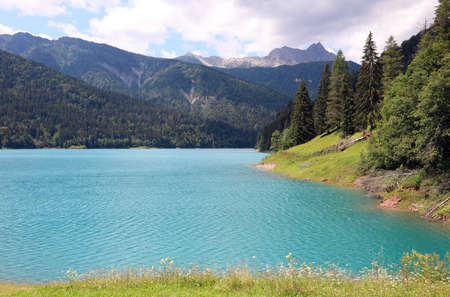 breathtaking alpine landscape with the lake near the village of SAURIS in Northern Italy