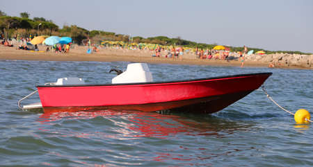 red motorboat to the rescue of bathers in the sea