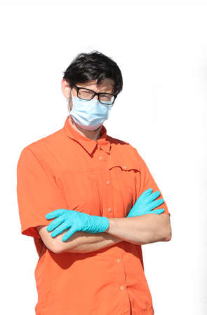 bespectacled doctor with surgical gloves and anticovid mask and white background