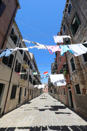 Incredible glimpse of the Italian island of Venice with Venetian houses and clothes hanging out to dry in the sun