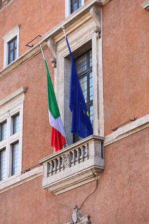 balcony of Piazza Venezia in Rome with the flag of Italy and Europe on and where the Duce looked out During the demonstration