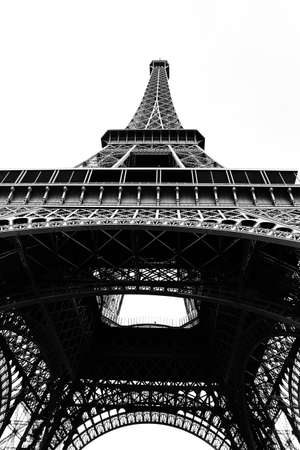 incredible views from below of the very tall Eiffel Tower with black and white effect in Paris France