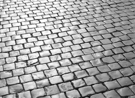 background of the pavement called cobblestones or Sampietrini in Italian Language of the Vatican City square in front of St. Peter's basilica