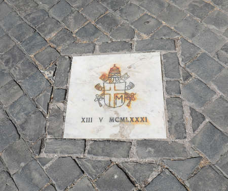 Vaticano City, VA, Vatican - August 16, 2020: MAttonella in Piazza San Pietro which indicates the precise place where there was the attention to Pope John Paul II on May 13, 1981 Éditoriale