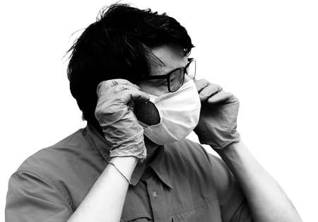 young doctor with glasses wearing surgical mask with antique effect in black and white