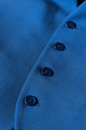 buttons of a blue gilet