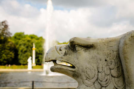 statue of an eagle and a fountain in the background photo