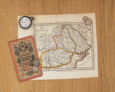 old map on table with old coins of distant and exotic states. memories of unforgettable adventures.