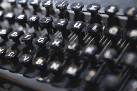 photo of the keyboard of an old typewriter in black color.  Stok Fotoğraf