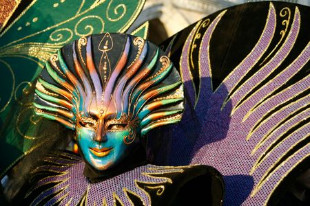 colore: During the Carnival, hundreds of people wearing wonderful colourful costumes and masks come to Venice from all over the world. Stock Photo