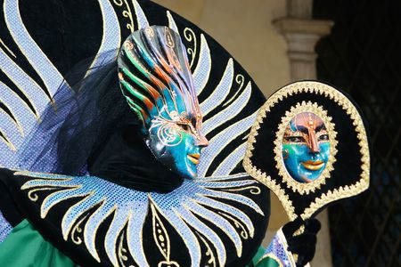 During the Carnival, hundreds of people wearing wonderful colourful costumes and masks come to Venice from all over the world. Stock Photo - 4232111
