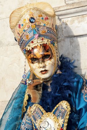 During the Carnival, hundreds of people wearing wonderful colourful costumes and masks come to Venice from all over the world. photo