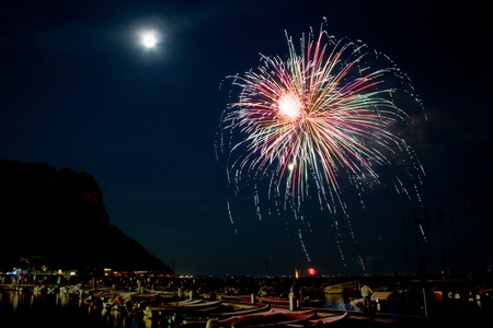 garda: Fireworks explode in the water in Garda Lake  Stock Photo