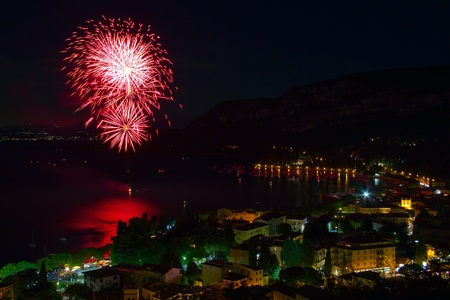 garda: Fireworks explode in the water in Garda Lake.