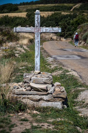 the french way: Cross saying Eva on Camino de Santiago, a Pilgrims Way in Spain Stock Photo