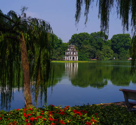 Hoan Kiem Lake Pagoda with green water and flowers Reklamní fotografie