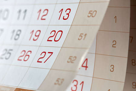 numbers on an annual, quarterly, large calendar that is opened and suspended Фото со стока