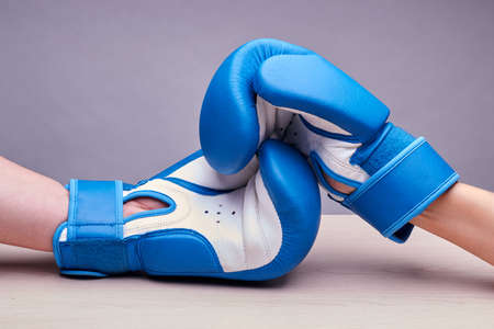 According to the requirements of AIBA all over the world hand in them is not compressed in a fist