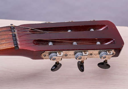 in the headstock with the peg line mechanism to adjust the tension of the strings