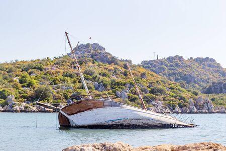 Wrecked ship on the shallow, sailboat, mediterranean sea, Turkey Stock Photo