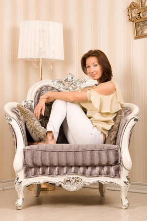 A girl sits in a vintage chair  photo