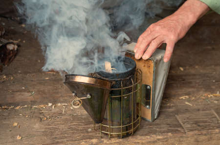 People kindle device for fumigating the bees with smoke.