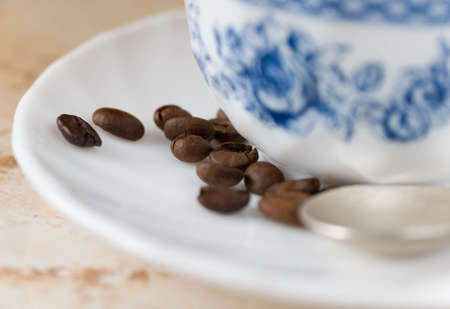 Some coffee beans, with cup of coffee, macro Stock Photo - 2671559
