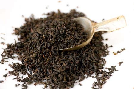 English tea with tea spoon on white