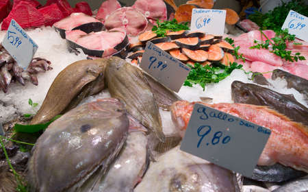 silver perch: Assortment of fresh fish on market stall Stock Photo